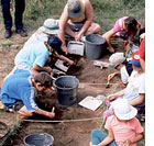 youth conducting an archaeological dig